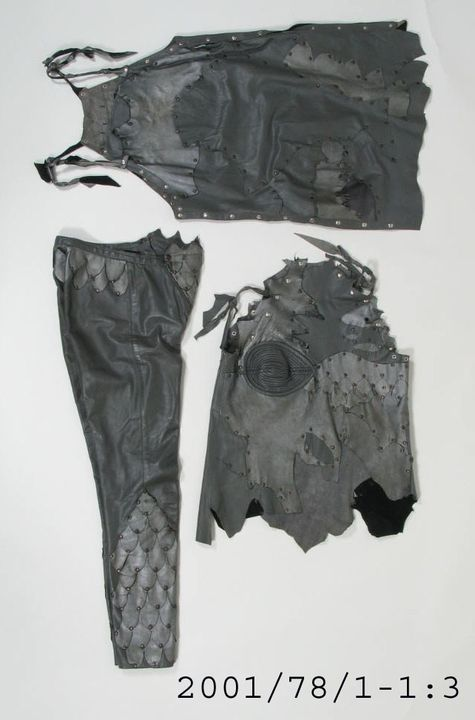 2001/78/1 Outfit, womens, pants/ top/ sleeves/ mini dress, leather with metal studs, designed by Jenny Bannister and Kati Mindszenti, made by Jenny Bannister, Melbourne, Australia, 1980-1982. Click to enlarge.