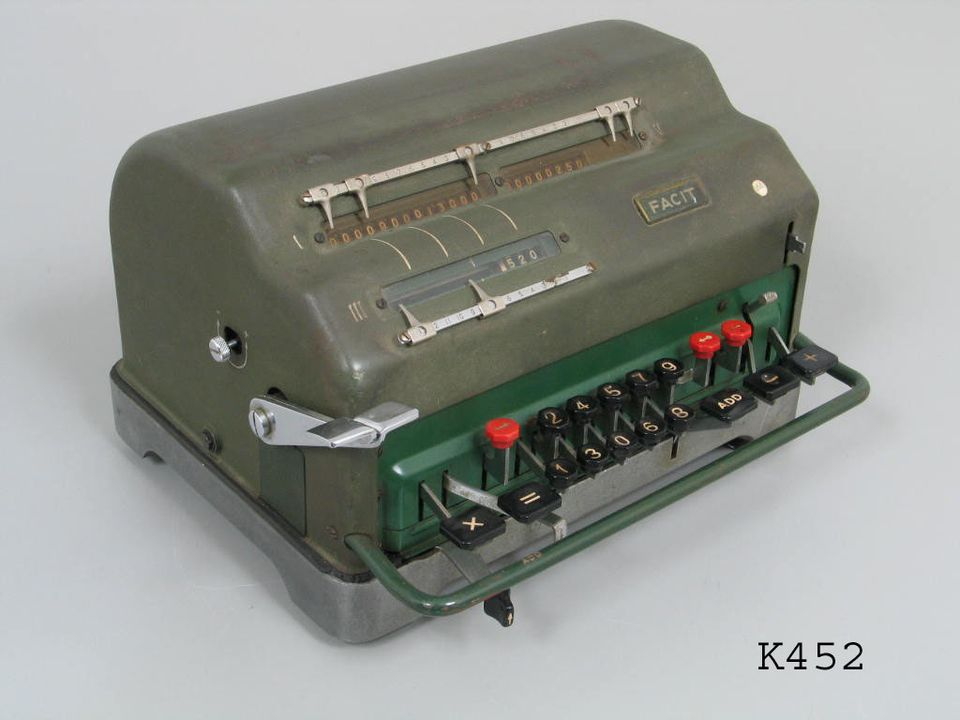 K452 Calculator, mechanical, hand operated by 2 levers, rectangular, metal case, dark green/grey finish, adds, divides and multiplies, 'Facit', Atvidaberg-Facit, Sweden, 1950s (OF).. Click to enlarge.