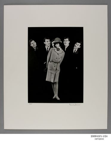2009/43/1-1/24 Photographic print, black and white, model Gillian Dickson in grey flannel suit with 4 cut outs of model Eric Hoek, produced for a Sportsgirl promotion, studio shot, by Bruno Benini, Melbourne, Victoria, Australia,1965