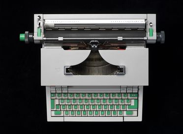 99/126/1 Typewriter, 'Olivetti Underwood Praxis 48', with attachments and manual, plastic / metal / electrical components / paper, designed by Ettore Sottsass, made by Olivetti, Canada, c.1965