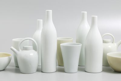 2002/79/1 Ceramic group, 'Still life with yellow bowls', teapots (2), bottles (4), beakers (3), bowls (2), wheelthrown and slipcast in Limoges porcelain and Southern Ice porcelain, made by Gwyn Hanssen Pigott, Ipswich, Queensland, Australia, 2002