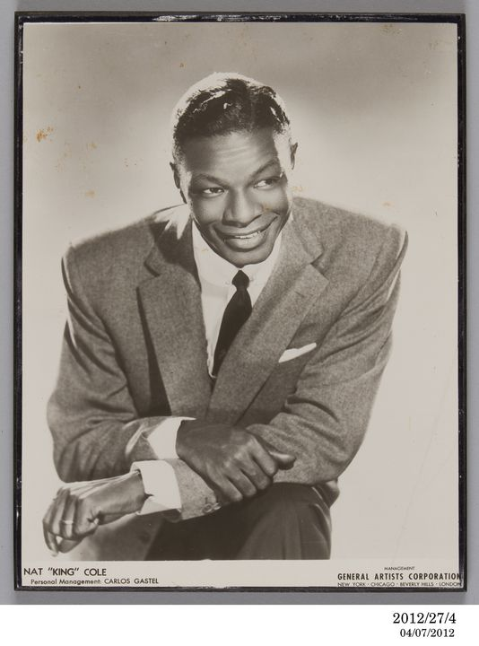 2012/27/4 Photographic print, publicity photograph of Nat 'King' Cole, paper / chipboard, photographer unknown, used by Lee Gordon and Max Moore, Australia, 1955. Click to enlarge.