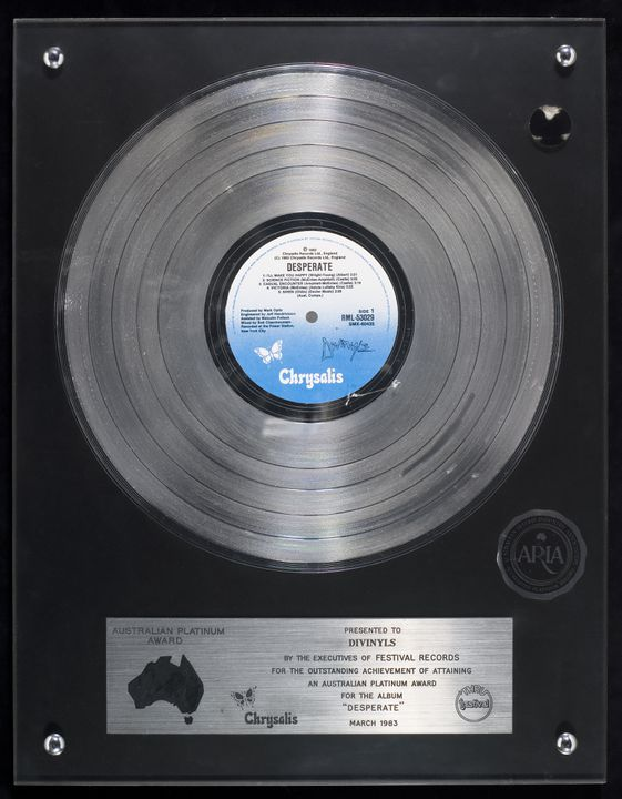 2007/50/20 Music award, platinum record, 'Desperate' by Divinyls, plastic / metal / acrylic, made and used by Festival Records, Sydney, New South Wales, Australia, 1983. Click to enlarge.