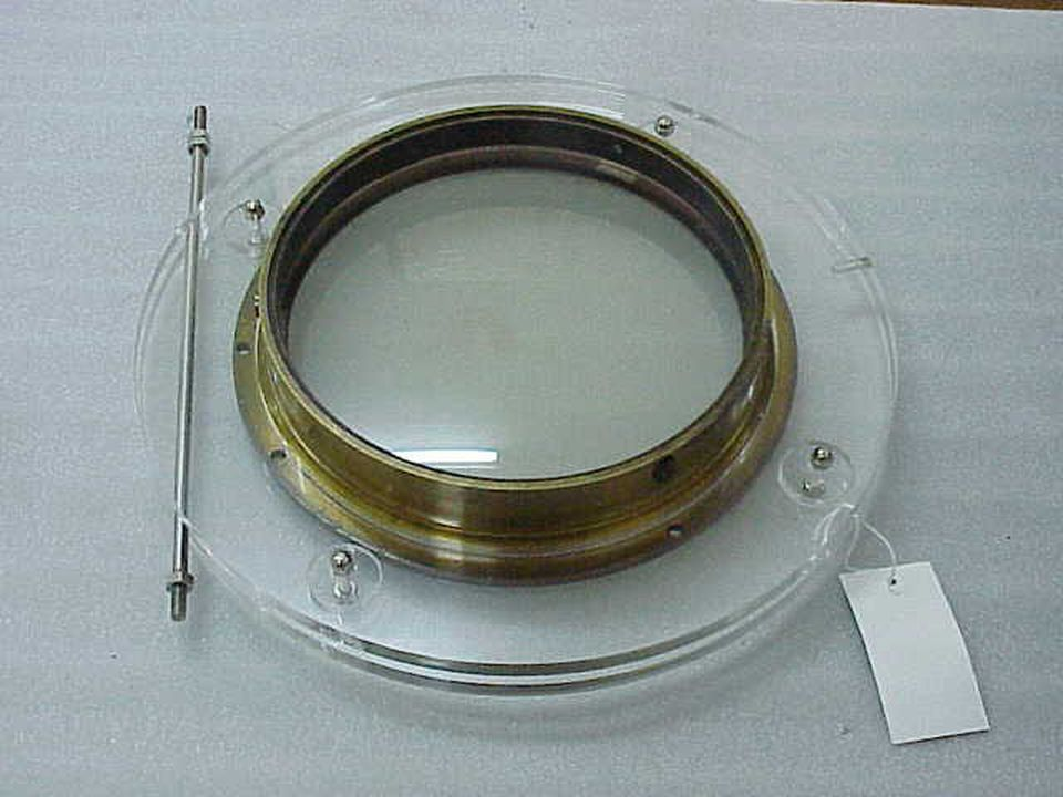 H10187 Astronomical lens, 7 1/4-inch, brass / glass, made by Merz and Son, Munich, Germany, 1860-1861, used at Sydney Observatory, Sydney, New South Wales, Australia. Click to enlarge.
