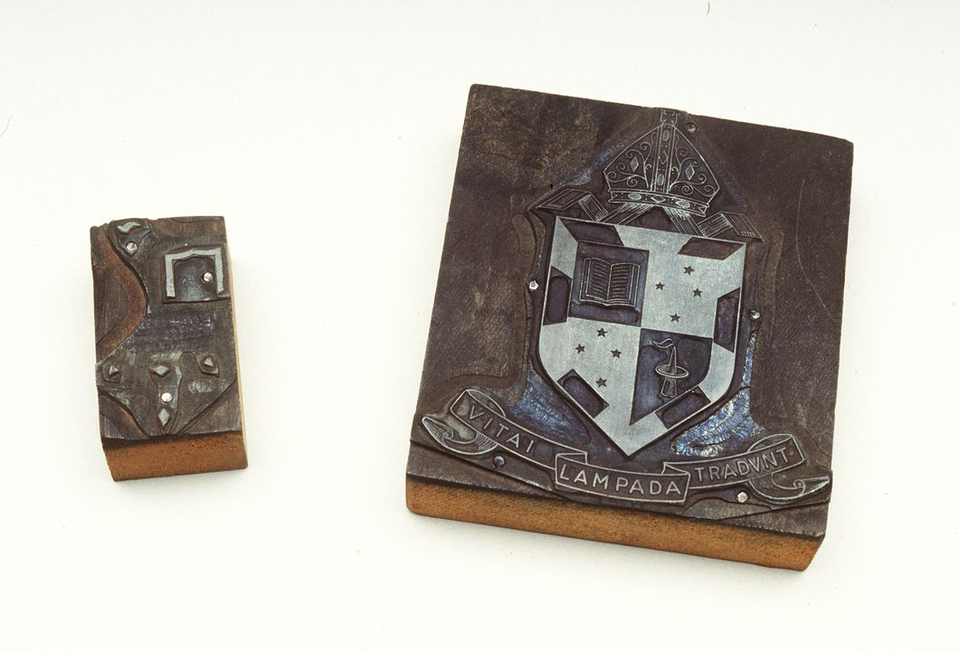 H9022-7/2 Printing dye, crest with shield & bishops mitre on top, marked yellow in pencil on side.. Click to enlarge.