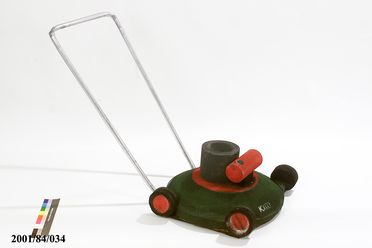 2001/84/34 Lawnmower, theatrical prop, foam / rubber / wood, designed by Dan Potra, made by Udo Förster, Rebecca Schipilliti, Andrew McDonnell, Nic Burton - Ceremonies Workshop, used in 'Tin Symphony' segment of Sydney 2000 Olympic Games Opening Ceremony, Sydney, New South Wales, Australia, 2000