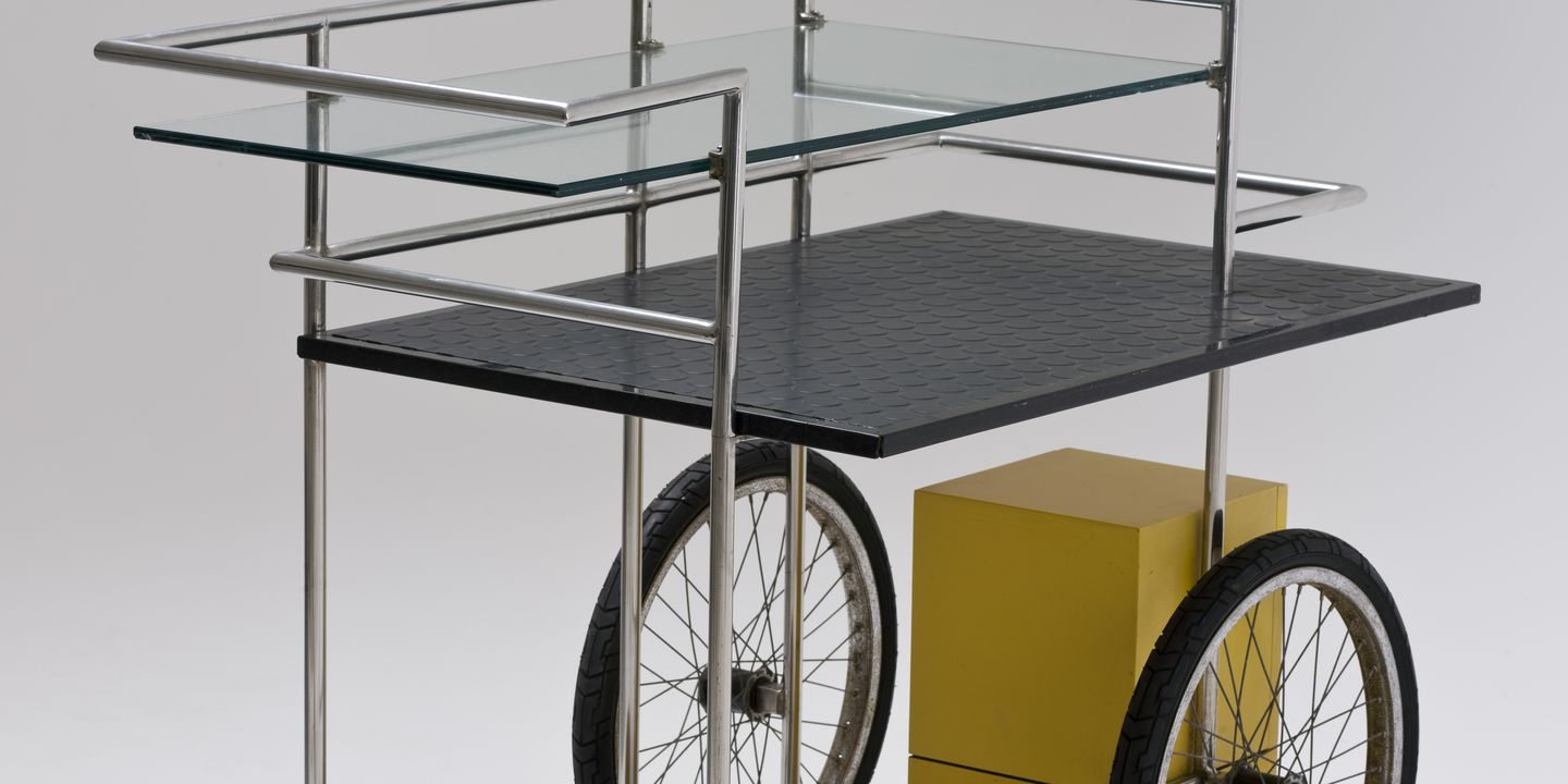 2009/94/1 Drinks trolley, steel / glass / Customwood / rubber / granite, Bilson's (Quay) Restaurant, designed and made by George Freedman, Tim Allison and Mark Shamburg, Sydney, New South Wales, Australia, 1988. Click to enlarge.