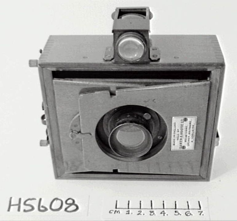 H5608 Camera, folding, metal / glass / wood, J. F. Shew & Co, London, England, c. 1902. Click to enlarge.