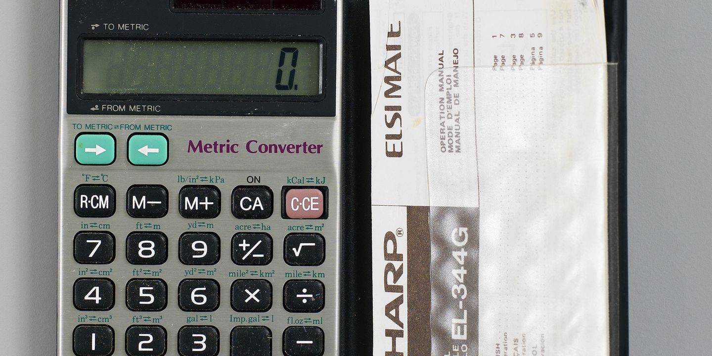 metric converter sharp elsimate in case with operation manual