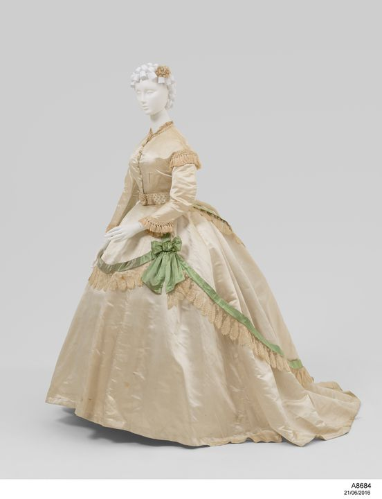 A8684 Wedding dress, made up of bodices (2), skirt, belts (2), rosette, silk / lace / pearls, maker unknown, England, c. 1865. Click to enlarge.