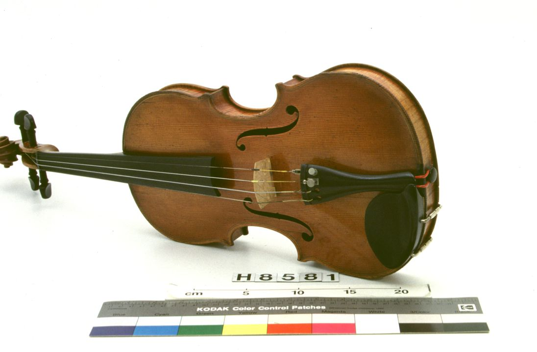 H8581 Violin with bow and case, timber / ebony / cat gut / metal, by John Devereux, Melbourne, Victoria, Australia, 1871. Click to enlarge.