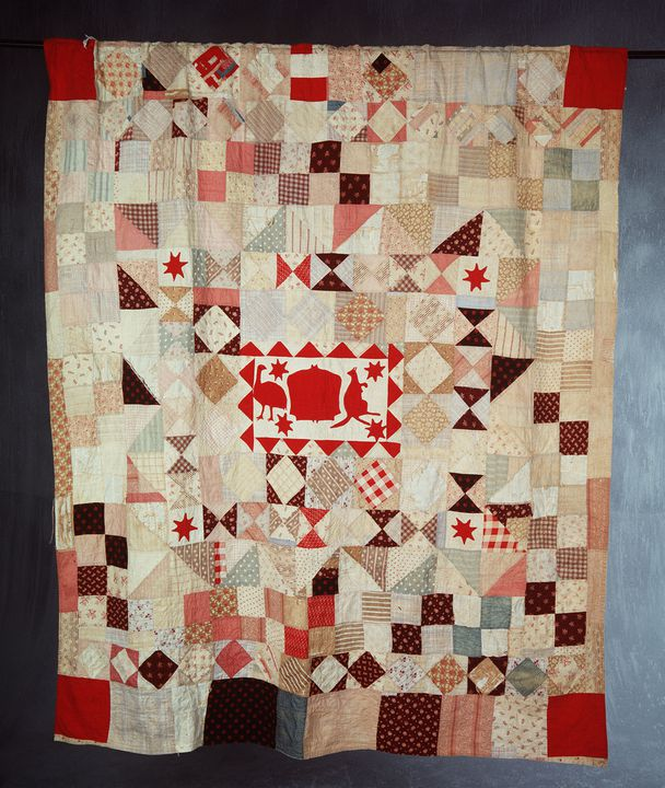 90/732 Patchwork quilt, cotton, medallion design with unofficial Australian coat of arms ('Logo'], made by Amelia Brown, Bowning, New South Wales, Australia, 1857-1900. Click to enlarge.