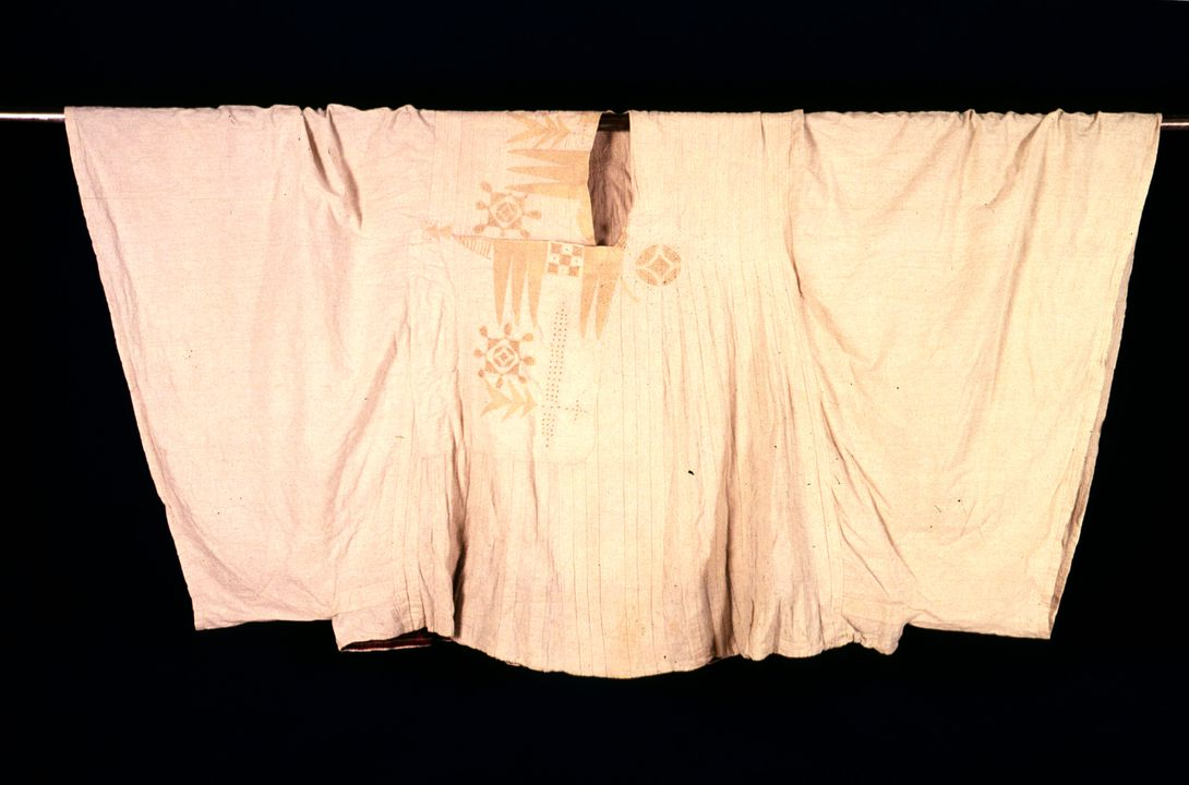 A8510 Man's tunic, narrow strip-weave cotton, embroidered asymmetrical design, Hausa people, Nigeria, West Africa, early 1900s. Click to enlarge.