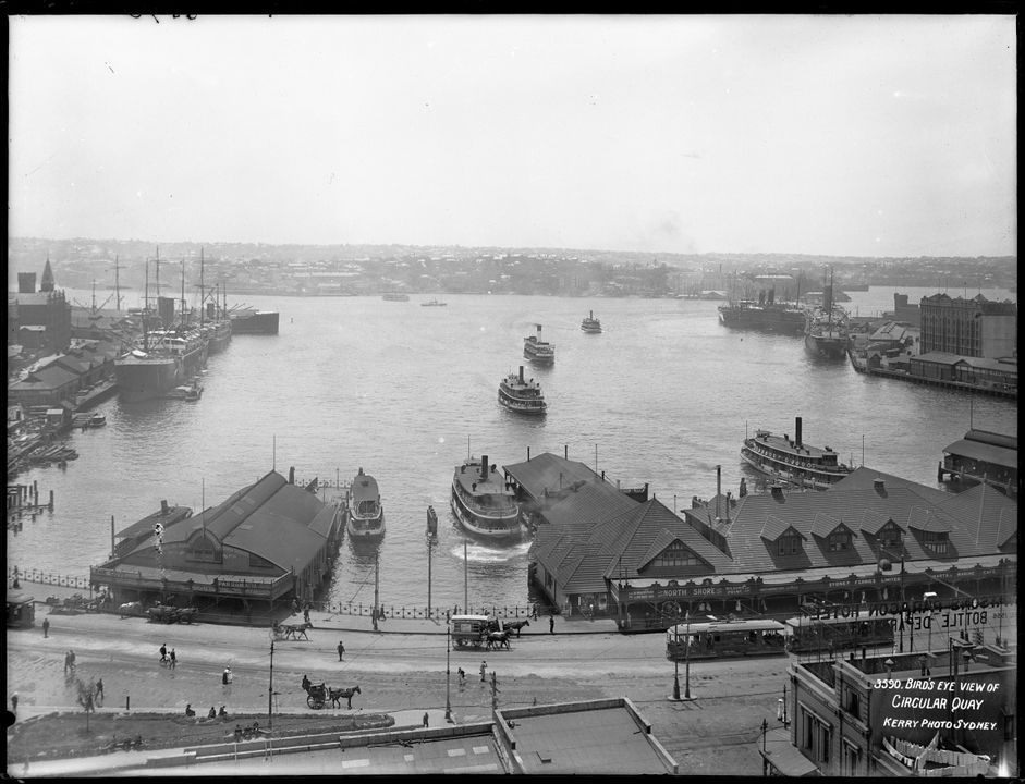 85/1284-1812 Glass negative, full plate, entitled 'Bird's Eye View of Circular Quay' depicting ferries, ferry wharves, ocean liners, trams and hansom cabs at Circular Quay, Sydney Cove, glass, photograph by Kerry and Co, Sydney, New South Wales, Australia, 1906-1910. Click to enlarge.