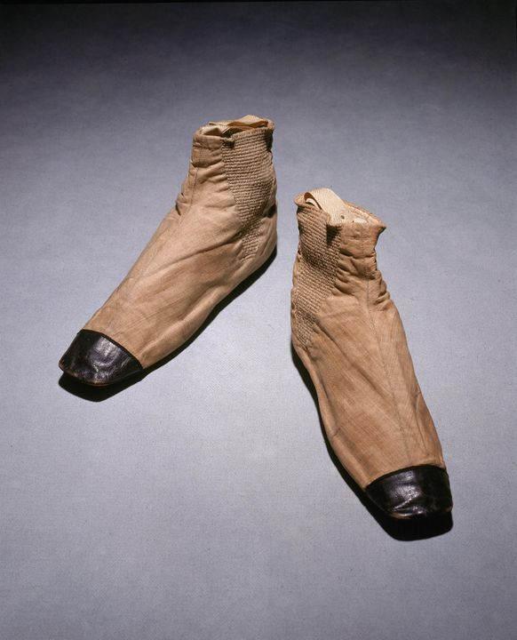 94/88/1 Boots (pair), with calling card, womens, worn by Queen Victoria, linen / silk / cotton / leather / metal / cardboard, designed and made by Joseph Sparkes Hall, London, England, 1837. Click to enlarge.