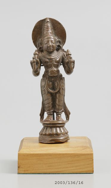 2003/136/16-1 Figure of Surya, from display, standing on lotus base, bronze, maker unknown, South India or Orissa, 1500-1700