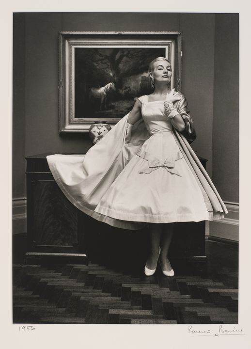 2009/43/1-1/4 Photographic print, black and white, model Gretta Miers wears La Petite of Collins Street, Melbourne ballerina length full skirt, location National Gallery of Victoria, photograph by Bruno Benini, Melbourne, Victoria, Australia, 1956. Click to enlarge.