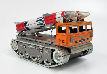 85/2573-1 Toy rocket transport and launch vehicle, with USAF Titan and Saturn rockets, metal, battery operated, made by Daiya, Japan, c. 1965, part of the Ken Finlayson toy collection