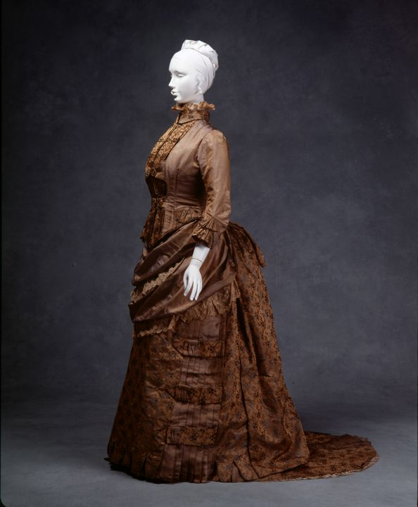 96/69/1 Day dress, womens, comprising bodice, skirt, train and collar, silk / metal, by W H McClelland and Company, worn by Lizzie Henrietta Harris, Sydney, New South Wales, Australia, 1883. Click to enlarge.