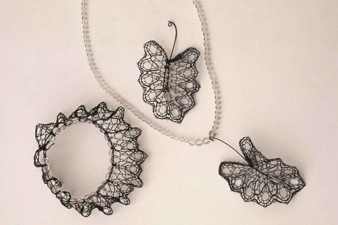 2002/51/1 Lace neckpiece and bracelet, 'Raindrops', bobbin made, oxidised silver wire and quartz crystal beads, Lenka Suchanek (b. 1961), Canada, 2001. Click to enlarge.