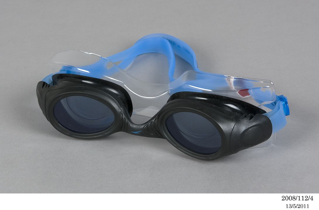 2008/112/4 Swimming goggles and packaging, rubber / plastic / paper, designed by Rei Kawakubo, Comme des Garcons, for Speedo, made by Speedo Australia Pty Ltd, China, 2007. Click to enlarge.