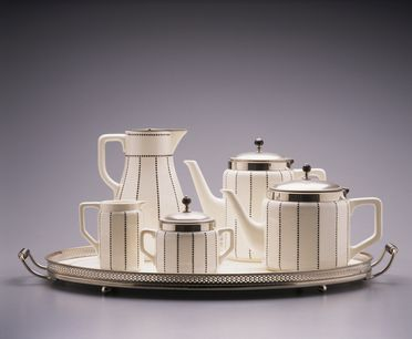 2005/66/5 Tea and coffee set, consisting of a teapot, coffeepot, hot water pot, milk jug, sugar bowl and tray, with transfer printed pattern, ceramic / electroplated silver / plastic, metal components made by WMF, Germany, c.1905, set made by the Waechtersbach Earthenware Factory, Schlierbach, Hesse