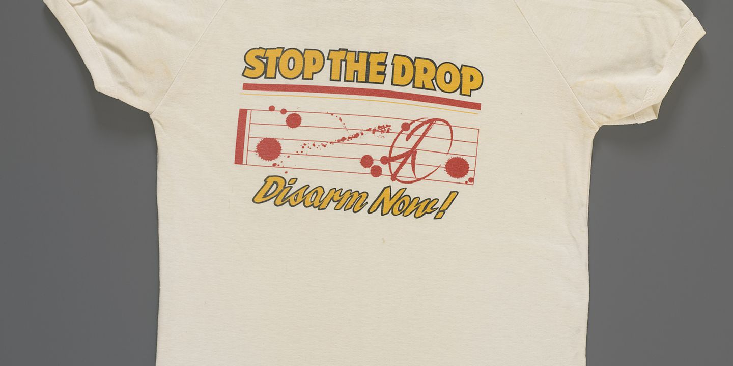 2008/42/1 T-shirt, nuclear disarmament, 'Stop the drop', polyester / cotton, maker unknown, worn by Kevin Fewster at the 'Stop the drop' concert, Melbourne, Victoria, Australia, 1983. Click to enlarge.