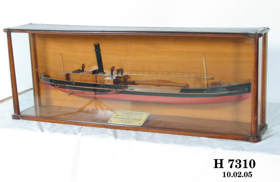 H7310 Half-ship model, TSS 'Antleon', builder's model in case, twin screw sand pump dredger built for New South Wales Government, wood / metal / glass, made by William Simons & Co Ltd, Renfrew, Scotland, 1898. Click to enlarge.
