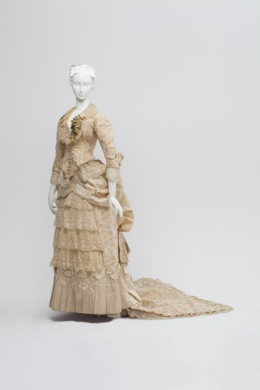 86/647 Wedding gown, comprising bodice, skirt and train, womens, silk brocade / satin / lace, maker unknown, worn by Elizabeth Jane Howard (nee Smith), Orange, New South Wales, Australia, 1883