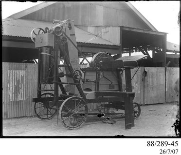 88/289-45 Photographic glass plate negative, Myee' travelling chaff cutter with single screw bagger, made by The Clyde Engineering Pty Ltd, Granville, New South Wales, Australia, 1900-1940