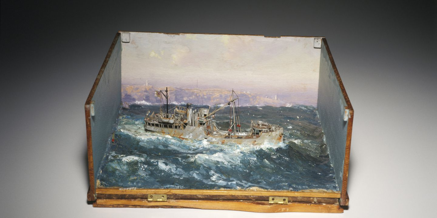 """B1977-2 Ship model, HMAS """"Bombo"""", minesweeper, miniature, complete with masts, aerials and rigging; set in painted plaster seascape (by John Allcot), in three-sided wooden box, R E Klippel, 1941. Click to enlarge."""