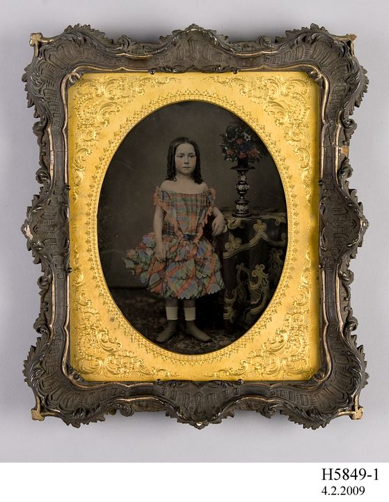 H5849-1 Photographic positive, studio portrait, hand-tinted ambrotype of the grand-daughter of Vice-Admiral Charles John Napier, collodion / paint / glass / wood / paper / metal / velvet, photographer unknown, England, 1855-1870. Click to enlarge.