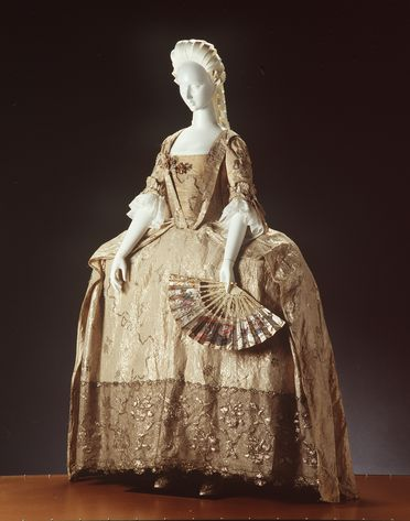 85/2801 Court dress, comprising open robe, petticoat, length of fabric and galloon (2), white silk brocade, maker unknown, England, c 1760