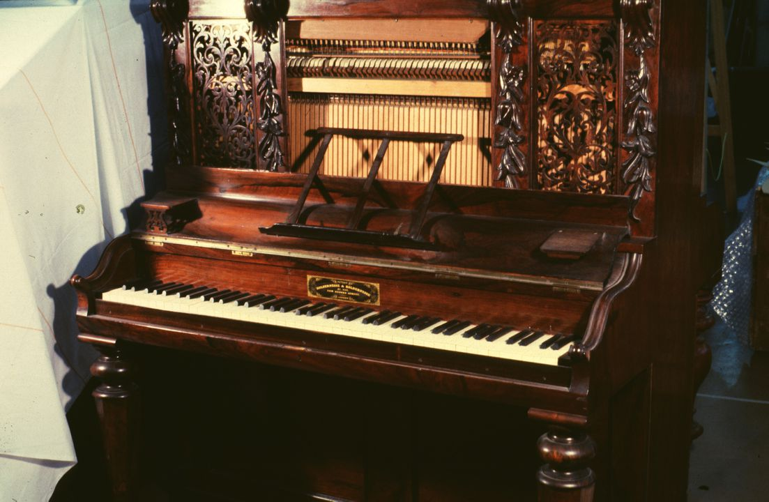H5314 Pianoforte with accessories, upright, elaborate fretwork panels, rosewood / mahogany / silk / felt / ivory / ebony / brass / metal, made by Holdernesse & Holdernesse, London, England, 1856 - 1880. Click to enlarge.