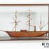 Image 1 of 3, H7267 Ship model (unfinished), of 1901 Antarctic research ship HMS 'Discovery', with model penguins (3) and display case, wood / glass / lead / paint, made by Frank Hurley, New South Wales, Australia. Click to enlarge