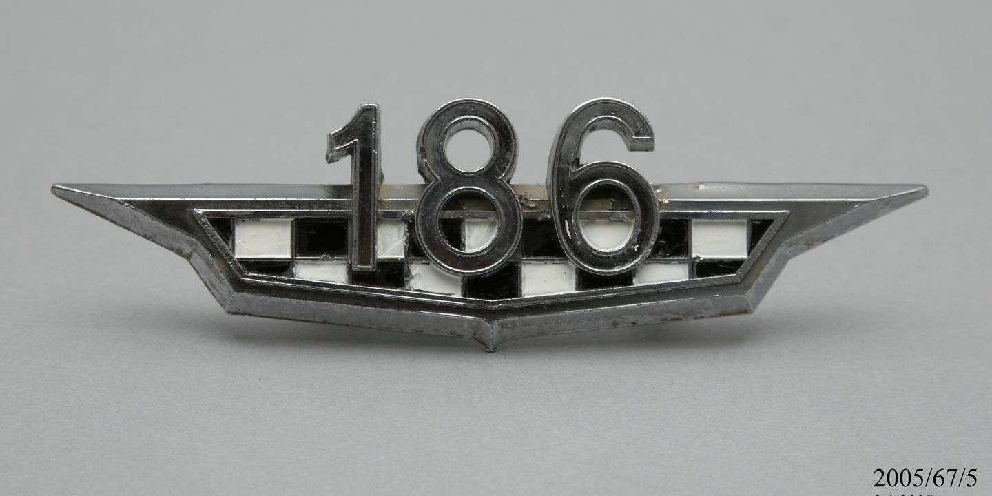 2005/67/5 Automobile badge, 'Holden HR', chrome/ enamel