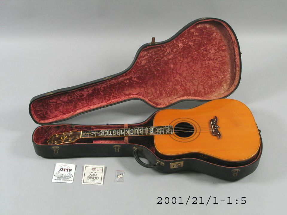 2005/21/1 Acoustic guitar with case and accessories, wood / metal / leather / fabric, made by Roger Buckmaster, Melbourne, Victoria, Australia, 1976. Click to enlarge.
