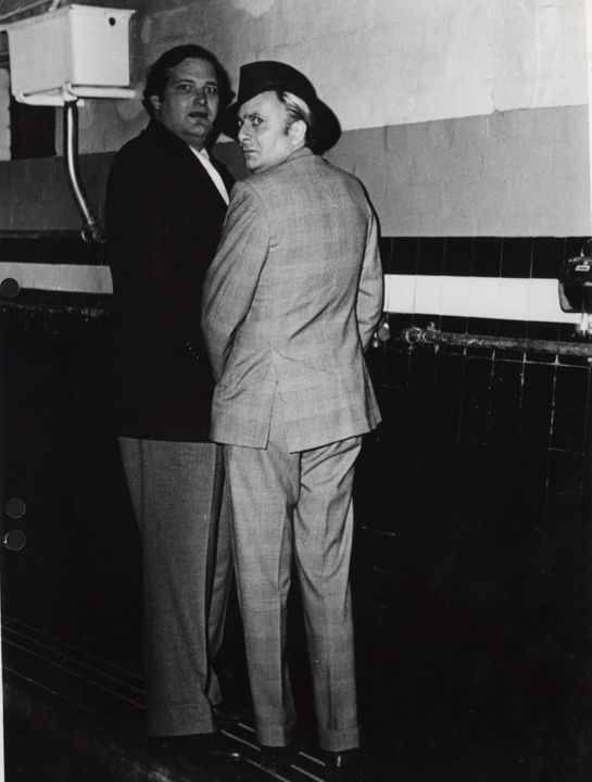 97/272/1-2/14 Photographic print, black and white, 'Taking a leak', Clyde Packer and Barry Humphreys at urinals in Luna Park, by Janice Wakely, Sydney, New South Wales, Australia, 1976. Click to enlarge.