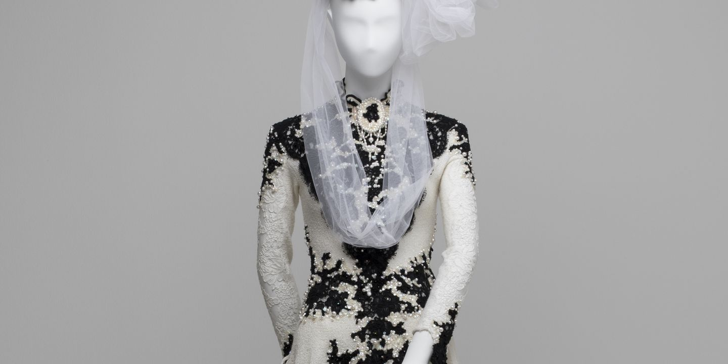 2005/32/1 Wedding outfit, acrylic / nylon / lurex / Alençon lace / 'Aurora' Swarovski crystals/ jet beads / pearls / tulle veil, worn by Claudia Chan Shaw on her marriage to Stewart White on Sunday October 17, 1993, designed by Claudia and Vivian Chan Shaw, made in the workrooms of Vivian Chan Shaw. Click to enlarge.