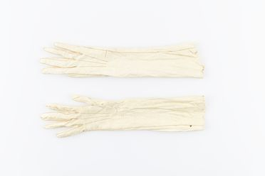 A7537-2 Gloves (pair), kid leather, possibly made by Farmers & Co, Sydney, New South Wales, Australia, worn by Mary Cameron Murray at her wedding to Varney Parkes, 1883