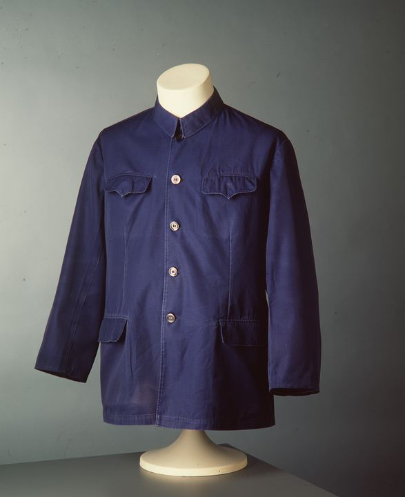 98/126/86 Jacket (zhifu) with coin in pocket, mens, cotton / plastic, unknown maker, China, 1970-1979 and 1991. Click to enlarge.