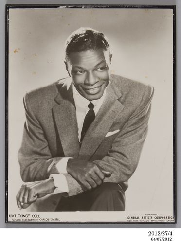 2012/27/4 Photographic print, publicity photograph of Nat 'King' Cole, paper / chipboard, photographer unknown, used by Lee Gordon and Max Moore, Australia, 1955