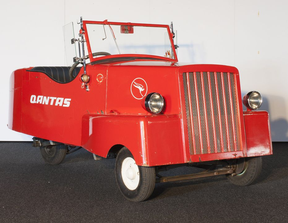 B2339 Car, home-made electric, in QANTAS livery, painted timber/metal/glass/rubber, made by Sir Roland Wilson, Canberra, ACT, Australia, 1942-1943, used by Sir Roland Wilson, Canberra, Australia, 1944-1947, QANTAS 1974, and the School of Applied Electricity, Department of Technical & Further Educati. Click to enlarge.