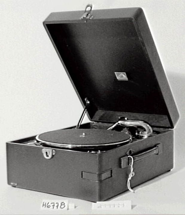 """H6778 Gramophone, portable, His Master's Voice, Great Britain, 1925-1935.(OF). H.M.V. portable gramophone mounted in patent leather case, c. 1930. Length 15"""", width 11 1/2"""", height 6 1/2"""".(SB).. Click to enlarge."""