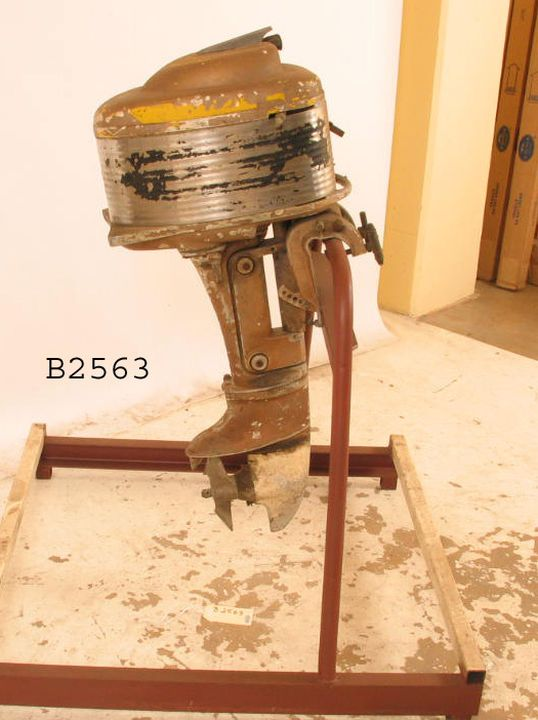 B2563 Engine, marine, outboard, Riptide 8hp outboard motor, 200cc, twin cylinder, cast aluminium motor enclosed by stainless steel shroud, 2 blade propeller, designer: L Sheltrum, Industrial Automotive Engineering Pty Ltd incorporating The Riptide Outboard Motor Company, Australia, c 1955 (OF).. Click to enlarge.