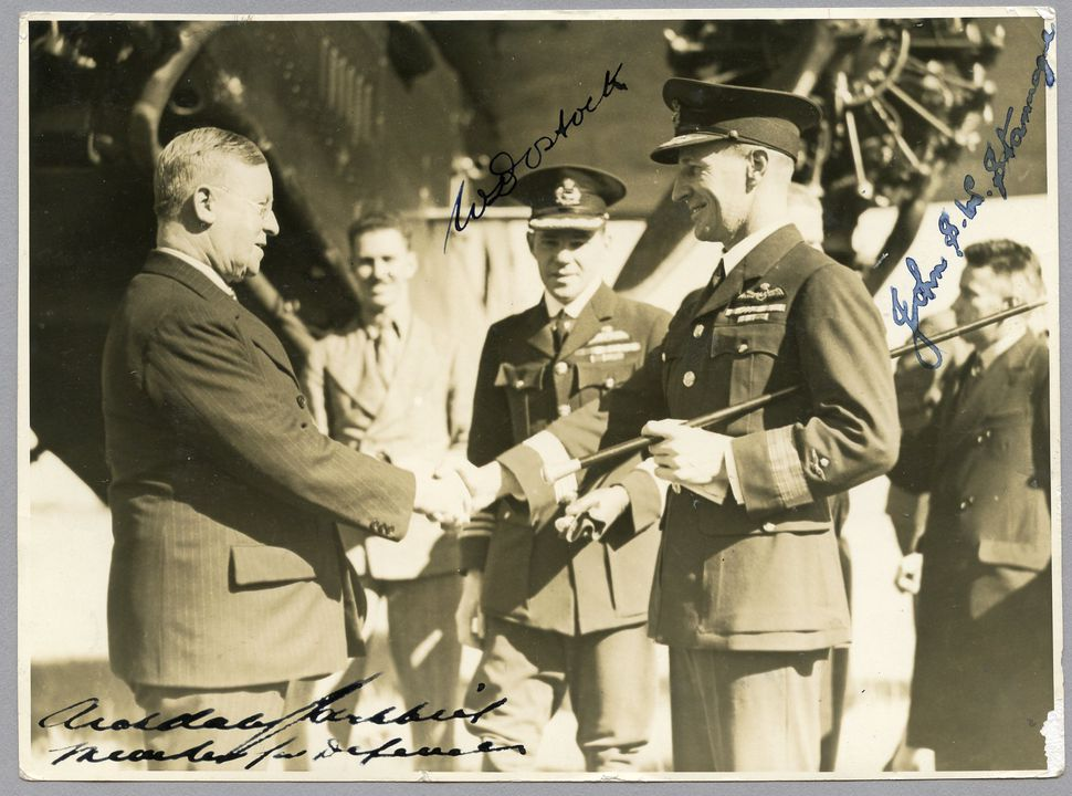 85/112-40 Photograph, black and white, Charles Kingsford Smith handing over the Southern Cross, paper, photographer unknown, Richmond, New South Wales, Australia, 1935. Click to enlarge.