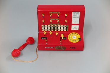 85/2577-122 Toy-Town telephone exchange, tin plate, distributed by CODEG (Cowan, de Groot Ltd), England, 1950s