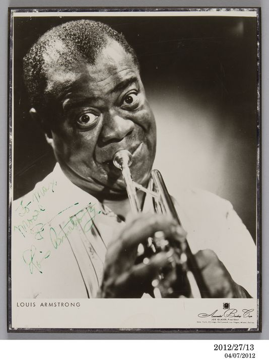 2012/27/13 Photograph, publicity, Louis Armstrong, autographed, paper / chipboard, photographer unknown, United States of America, used by Max Moore, Australia, 1956. Click to enlarge.