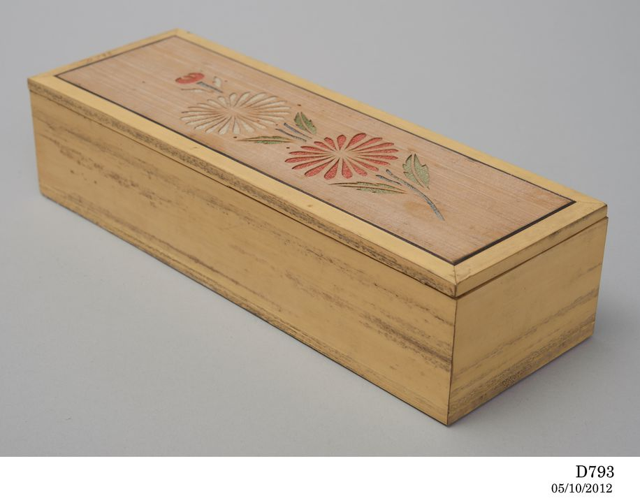 D793 Box with lid, flower design, wood / fabric, maker unknown, collected by Reverend Julian Tenison-Woods, Japan, 1885-1886. Click to enlarge.