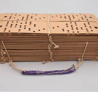 2010/1/272 Punch cards with sample of ribbon, Jacquard weaving loom, paper / jute / textile, maker unknown, place of production unknown, c. 1875-1900